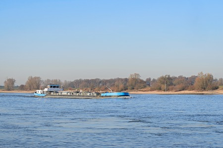 Tank transport by ship at Dutch river the Waal Imagens
