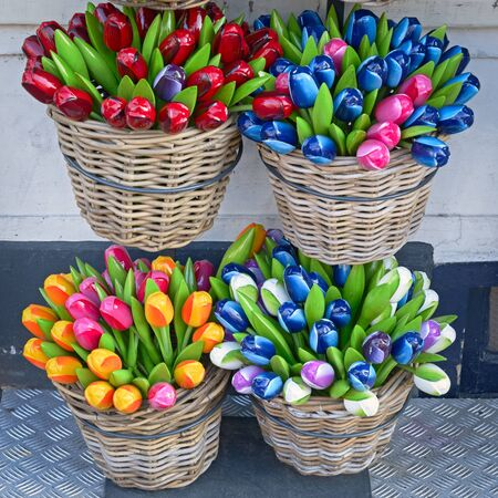 Colorful wooden artificial tulips in baskets Imagens