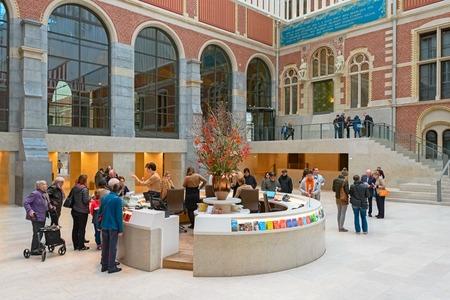 UTRECHT, THE NETHERLANDS, DECEMBER 25, 2015 -  The information desk in the new atrium of the Rijksmuseum. The new atrium were designed by the Spanish architects Antonio Cruz and Antonio Ortiz.