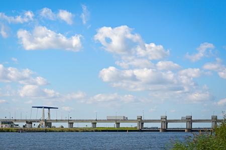 NIJKERK, THE NETHERLANDS, SEPTEMBER 23, 2016 -  Drawbridge and locks near Nijkerkerk. These locks seperate two waterways: the Nuldernauw and Nijkerkernauw.
