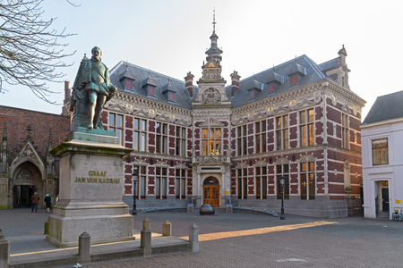 UTRECHT, THE NETHERLANDS, JANUARY 26, 2017 - Academiegebouw: University Hall of Utrecht University and statue of Count -Graaf- Jan van Nassau in Dom Square
