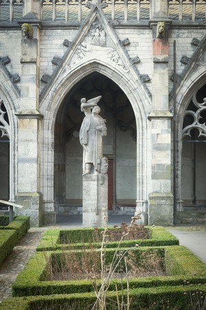 UTRECHT, THE NETHERLANDS, JANUARY 26, 2017 - View from the cloister of the Pandhof on the statue of Jan van den Doem made by Paul Gregoire. Van den Doem was architect of the Pandhof and the Domchurch Editorial