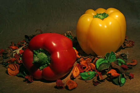 pungency: Still-life with red pepper, yellow pepper and petals