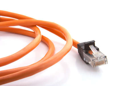 Orange cable with RJ-45 jack closeup view Stock Photo