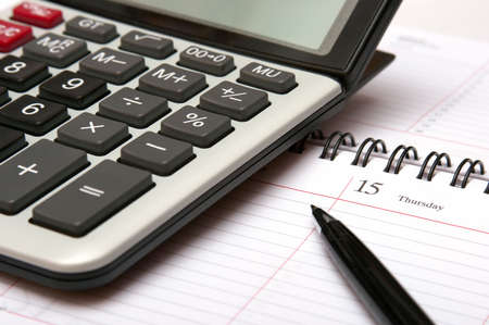 Close up of a calculator, organizer and pen.  Stock Photo