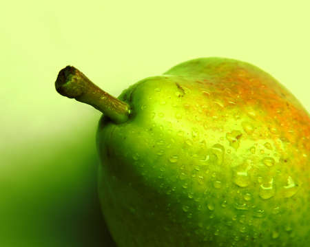 Green pear on a gradient background closeup Stock Photo