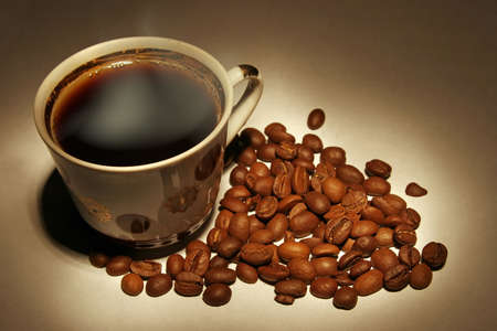 Still-life with hot coffee and coffee beans