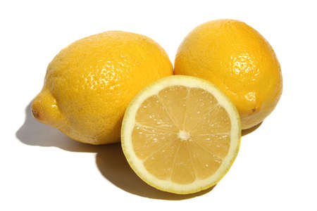 Two lemons and half of lemon on a white background