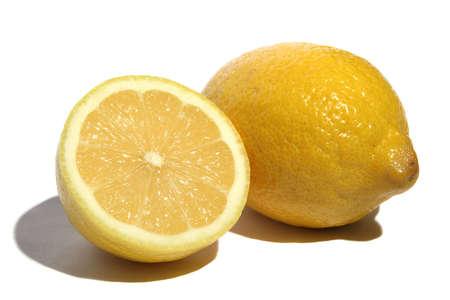 Lemon and half of lemon on a white background