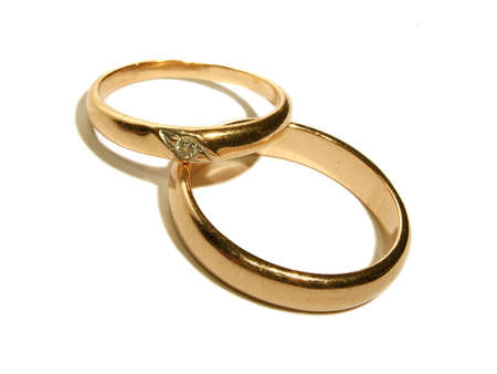 Two wedding gold rings close up