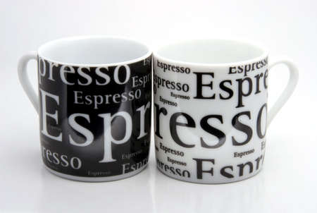 Black and white coffecups with an inscription