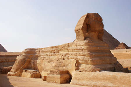 Sphynx and pyramids on a background of the sky