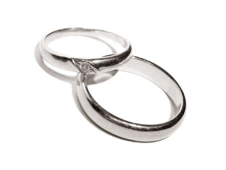 Two wedding gold rings close up platinum toned version Stock Photo
