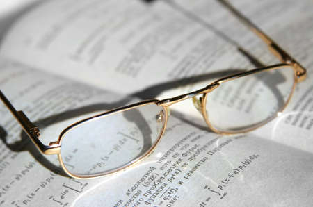 The book and glasses close up