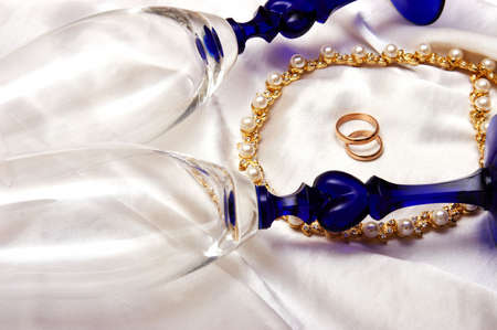 Wedding rings and champagne glasses