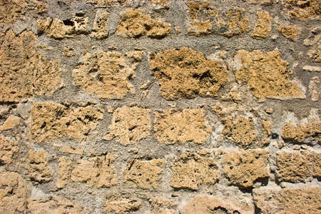 The obsolete yellow brick wall Stock Photo