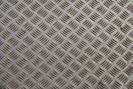 Dirty and scratched steel diamond plate background Stock Photo - 5380409