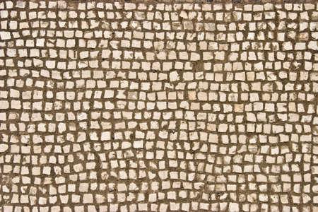 Old beige stone mosaic texture