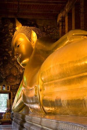 Golden buddha statue in Grand Palace (Bangkok, Thailand)