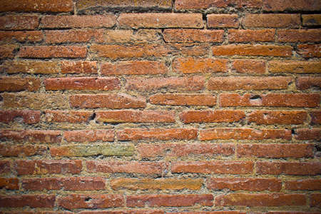 Old red brick wall with dark corners for design background Stock Photo
