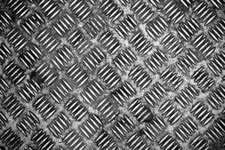 Scratched and dirty diamond metal plate background