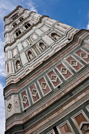 Giotto's Campanile is a free-standing bell tower that is part of the complex of buildings that make up Florence Cathedral on the Piazza del Duomo in Florence, Italy Standard-Bild
