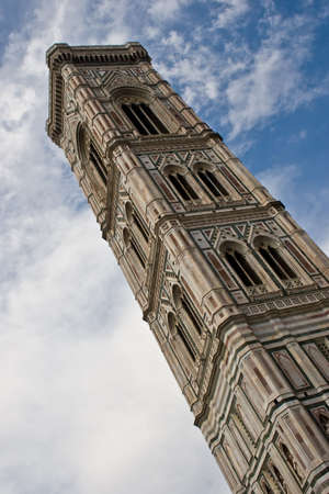 Giotto's Campanile is a free-standing bell tower that is part of the complex of buildings that make up Florence Cathedral on the Piazza del Duomo in Florence, Italy