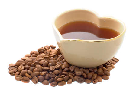 Heart shape coffee cup with coffee beans isolated over white Stock Photo