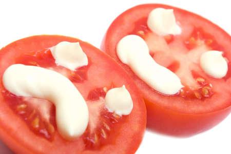Happy and sad smiles on tomato isolated over white Stock Photo