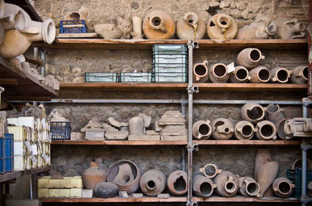 Shelves with amphoras (archaeology background)
