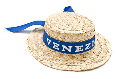 Straw hat with blue ribbon isolated on white