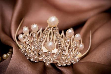 Platinum tiara on a silk background