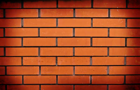 Vignetted red brick wall background Stock Photo
