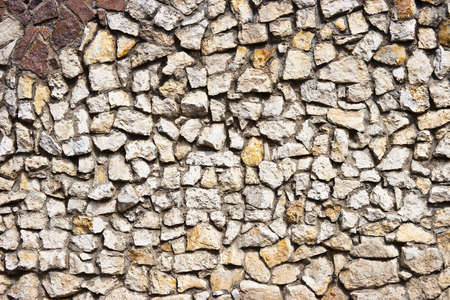 A textured pattern on a stone wall.