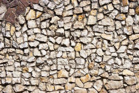 A textured pattern on a stone wall. Standard-Bild