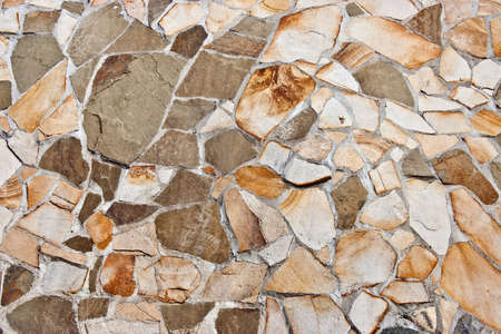 Wall covered in natural stone of irregular shapes  Stock Photo