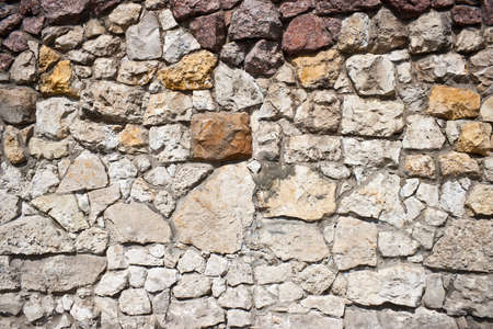 Details of a handmade, stone wall.