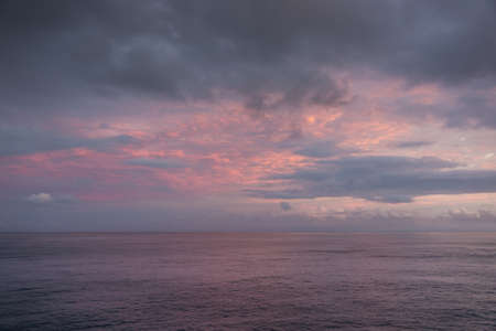 greenish blue: Blue hour with clouds of different colors. High clouds are orange and red, low clouds greenish blue