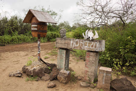 post card: Barrel as post box on Floreana Island. Selective focus on de post box, background in soft focus