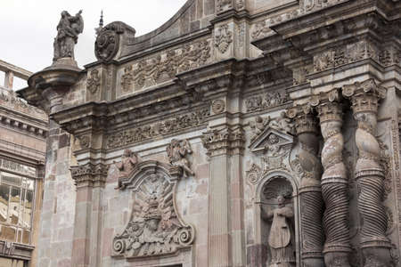 iglesia de la compania: Left part of the facade of the Church of the Society of Jesus showing not only fine sculptures but also overall extensive wear in the form of small dimples and discolorations