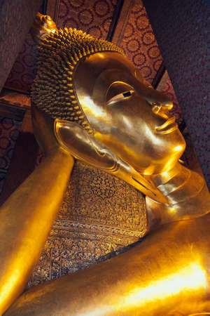 reclining: Head of the reclining Buddha in the Wat Po temple Stock Photo