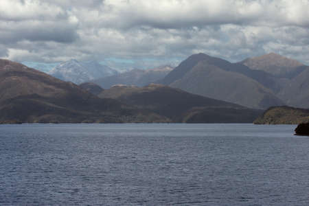dusky: Distant snowcapped mountains in Dusky Sound Stock Photo