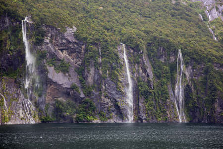 milford: Waterfalls pooring down in Milford Sound Stock Photo