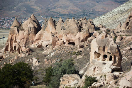 troglodyte: Fairy chimneys at the entrance of the Zelve Valley Stock Photo