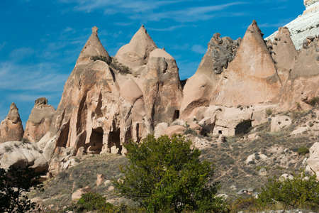 troglodyte: Fairy chimneys and collapsed troglodyte houses Stock Photo