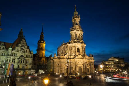 oper: The Hofkirche with the Residenzschloss and the Semperoper at nightfall Editorial