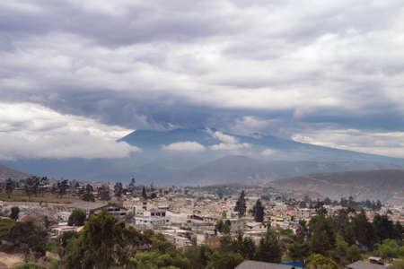 disturbance: Heavy weather gathering around the volcanoes surrounding Quito. Haze and atmospheric disturbance soften the focus