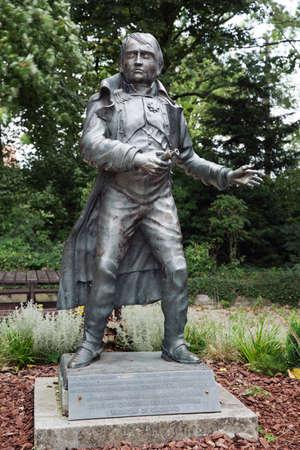 orange nassau: Napoleons statue at Le Caillou farm Stock Photo