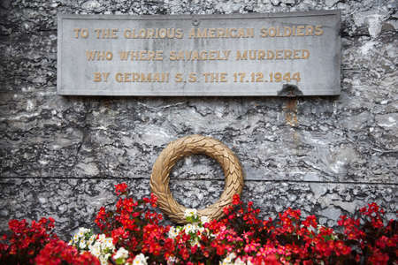 killings: Detail of the monument for the 8 killed american war prisoners in Ligneuville Stock Photo