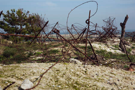 ww1: The surrounding landscape seen through the barb wire Stock Photo